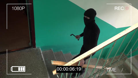 the masked robber breaks removing the surveillance camera mount Footage