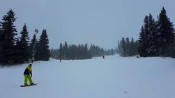 Nature, landscape. Tourists and riders on pistes of alpine ski resort. Aleko Bild