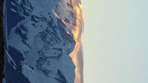 Vertical video. Sunrise in the mountains. Time Lapse Footage