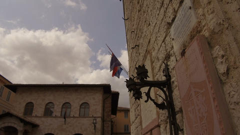 close up medieval flag bearer in central Assisi Footage