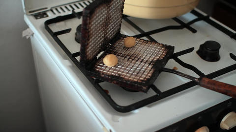 Woman Backes Crackers Cookies In A Waffle Iron stock footage