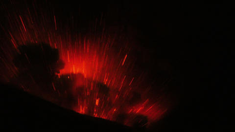 extremely violent volcanic eruption in the night large volume of red lava blows Footage