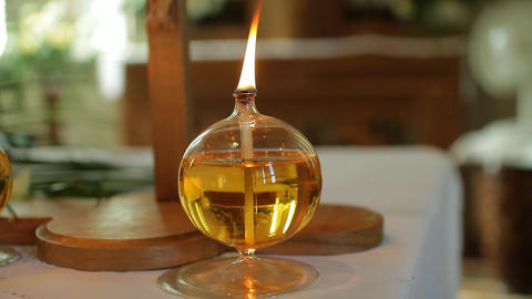 Little Petroleum Lamp On A Table With burning Flame