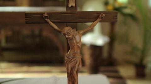 Little Crossed Jesus Figure On A Table Footage