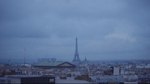 The Eiffel Tower in Paris in the evening view from a rooftop Footage