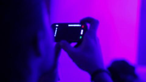 Audience is shooting DJs as they perform in night club Footage