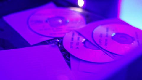 Hands of DJ take disks from the deck during performance in night club Footage