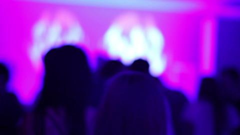 Dancing girl in night club. Audience dancing to rhythmic music. Kisses, hugs Footage