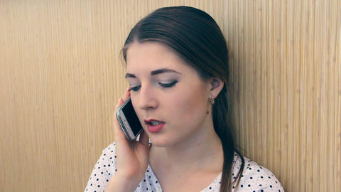 Girl emotionally speaks on the phone Footage