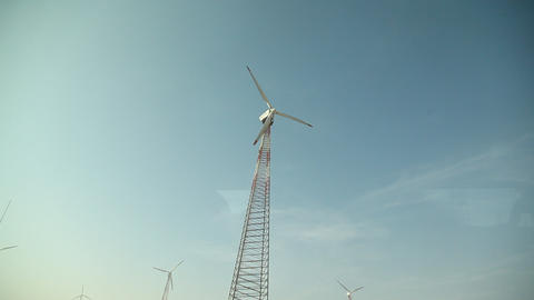 rotating windmill for pumping water over blue sky Footage