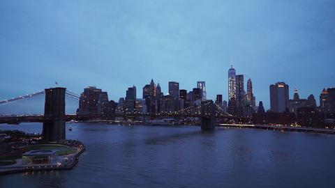 Nice evening shot of Manhattan downtown skyline with Brooklyn Bridge - MANHATTAN Live Action