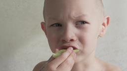 child boy eats a cucumber Footage