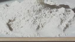 pour a heap of flour slow motion Footage