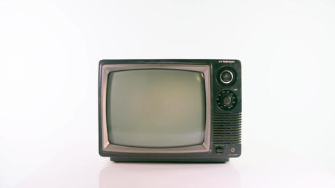 Zoom in on old fashioned TV on white background Live Action