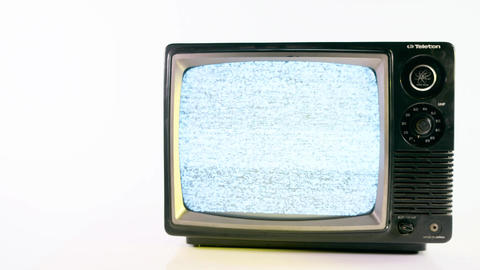 Pan of old fashioned TV with yellow light on white background Footage