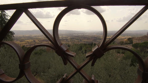 camera passes in the middle of an iron railing, Assisi Footage