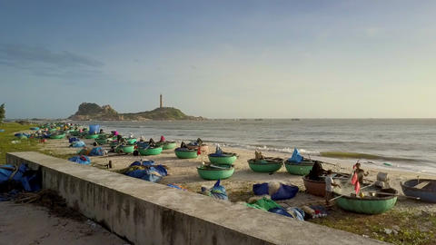 Wooden Round Boats on Sand Beach against Lighthouse Footage