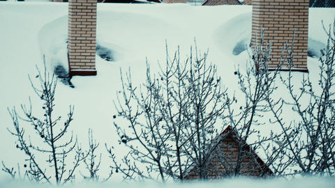 Snow covered sloped roofs of residential houses in winter Footage