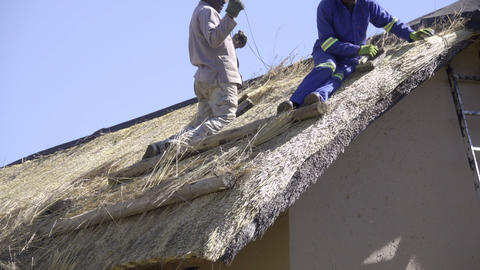 African construction workers fixing roof Footage