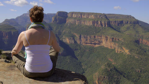 Back of woman meditating on her journey Footage