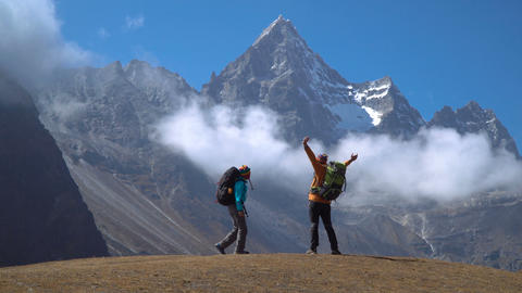 Hikers travel in the Himalayan mountains Footage