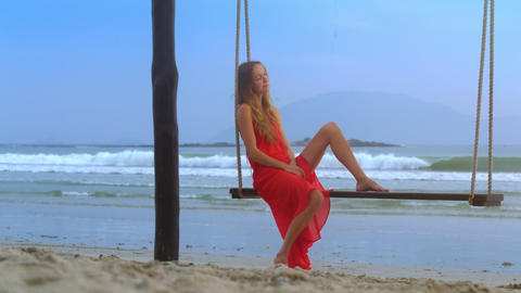 Woman Takes Pleasure in Rest Swinging on Beach Closeup Footage