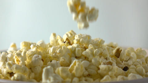 Pouring popcorn into box. Cinema or fast food concepts. Super slow motion dolly Footage