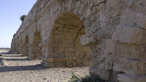 Pan of aqueduct near coast of Caesarea Footage