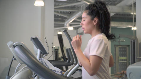 Young woman increase speed on treadmill and running Footage