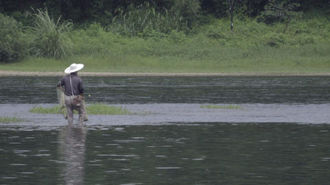 Chinese fisherman using a net to fish Footage