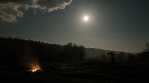 The bonfire goes out and the camera is in the background of the moon, Russia. Footage