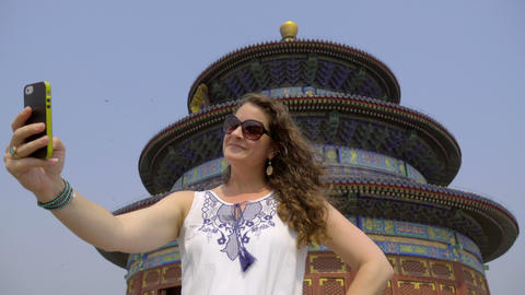 Sunglass wearing woman takes selfie at Temple of Heaven Footage
