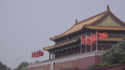 Chinese flags wave outside Forbidden City Footage