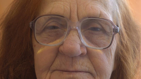 close up portrait of a elderly woman looking at the camera Footage