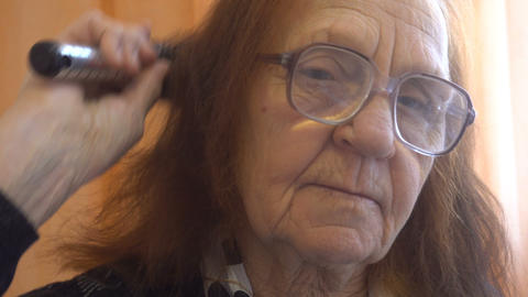 Old Woman Combing Her Hair At Home Footage
