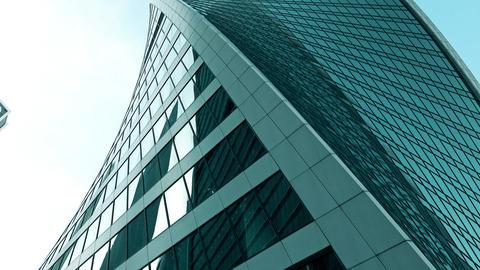 Modern skyscraper zoom out tilt shot, 4K. Spiral DNA-like design Footage