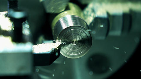 Lathe machine in action, super slow motion. Machining brass piece 250 fps macro Footage