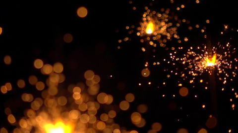 Three orange sparklers against dark background. Super slow motion shallow focus Footage