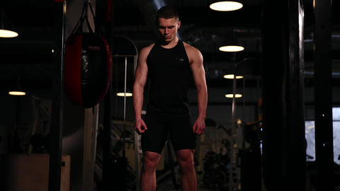 A professional athlete performs a one-weight dumbbell with left and right hand Footage
