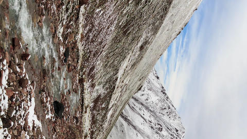 Vertical video. Snow melts in the mountains. Time Lapse Footage