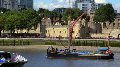 Old boat on the Thames London passing The Tower of London Live Action