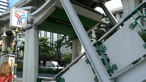 Girl walks at the stairs towards Phrom Phong BTS Station Footage