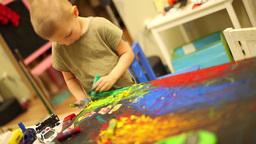 child draws paints, boy paints Footage