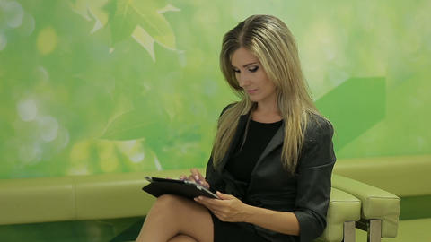 Business woman using a pad to search for business options… Stock Video Footage