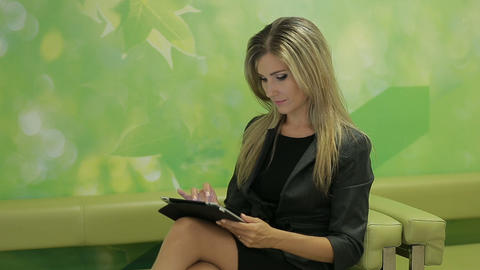 Business woman using a pad to search for business options and solutions ビデオ