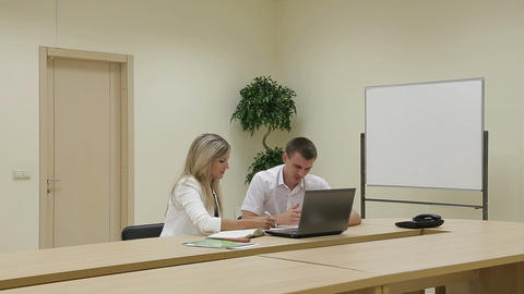 Sales manager talking to client, business presentation on laptop Footage