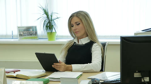 Businesswoman is talking to her mobile assistant in office on table Footage