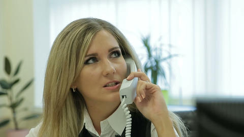 Business woman speaks on the phone. Lady in the office. Clerk at work Footage