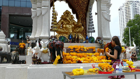 Girl Prays and places flower at Phra Pikanet Footage