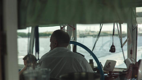 Silhouette Of Captain Steering Boat Footage